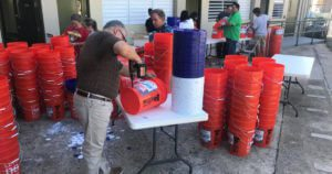 Volunteers prepare buckets